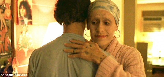 Ron offers Rayon a hand shake. Rayon opens his arms. They hug. Ron whispers a heartfelt, thank you
